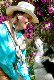 Krista Cantrell, cognitive animal behaviorist, qigong practitioner, shaman, and agility instructor, with her Border Collie Jet